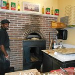 Alphonso has a way with a brick oven for bread and pizza