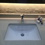 Sink with decorative wall and back-lit mirror