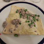 Cheese Ravioli with green peas and mushrooms in a cream sause