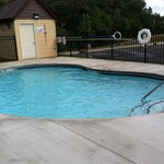 The pool is open. The depth starts at 3.5 and ends at 4.5. There is an outdoor shower available
