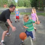 Dads and kids have fun playing basketball!