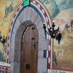 Mural and gargoyles in dining room at Castello