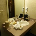 Nice vanity area in the room (separate from shower & stool)