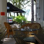 Looking from inside past outdoor seating to beach