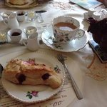 tea and delicious scone with jam, cream and butter