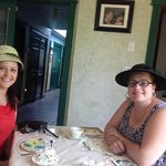 wearing our borrowed hats at the tearoom