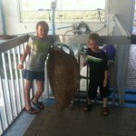 My daughter and nephew standing next to a turtle shell at the Turtle Cove