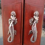 Mermaid door handles!  Cute!