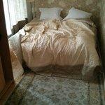 Это меньшая спальня
