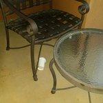 Garbage under patio chair.