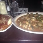 Ravioli with marinara sauce and veal with mushrooms.