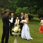 Simple wedding ceremony on front lawn