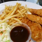 Chicken tenders, fries, slaw and bbq sauce.
