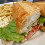Snapper sandwich, fries and slaw.
