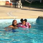 husband and granddaughter in the pool as you can see the big crack in the cement