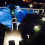 View of pool at night lit up