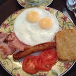 Eggs overeasy, ham, sausage, hash brown and tomatoes.  Served hot!  Delicious!