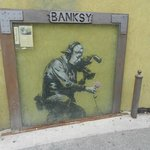 Banksy on Side of a Wall