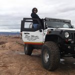 wife posing with the jeep