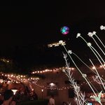 Twinkly lights, trumpet vine winding on the trellis, wine, and music