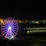 watching ferris wheel and ferry from room at night