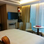 Deluxe room, big and surrounded by window.