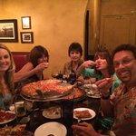 Happy Family Fully Enjoying Spinatos Pizza!