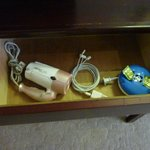 Hair dryer and USB cable in the drawer