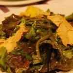 Foie gras over salad greens