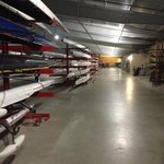 Shared Boathouse. You have to pay to be a member and there are beginners lessons for a fee.