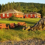 The rock with the firepit, and other cabins