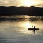 A fellow guest kayak fishing
