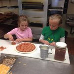Helping to make pizza