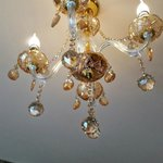 Chandalier over the bed
