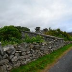 Stone walls and outbuildings from ancient farms line the road to Doolin town.