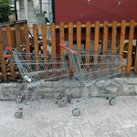 2 old unsightly shopping trolleys by the Taverna