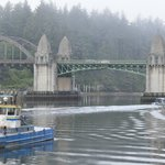 Fishing boats coming & going under the bridge.