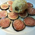 An improvised dessert - fresh figs, ice-cream, lemon shavings.