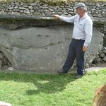 Our tour guide explaining a carved stone at Newgrange.