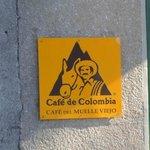 Logotipo do Cafe del Muelle Viejo.
