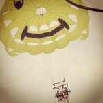 The smiley yellow parachute is sure to make you happy