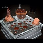 chocolate mousse, chocolate cupcake/soufflé with molten chocolate center & chocolate truffle cov