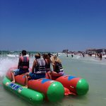Banana boat ride my kids loved. A fee but worth it.  A different company owns these but right by