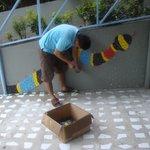 Staff member composing mosaic