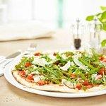 Pizza Bruschetta with rocket, Parmesan, homemade tomato sauce and mozzarella