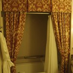 Never seen what looked like curtains around a shower... but it's a resort