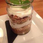 Breakfast parfait -  layers of fresh berries, toasted muesli, natural yogurt and berry compote