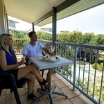 Enjoy the views from a one bedroom apartment balcony overlooking the pool