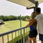 Watch a game of croquet from a studio balcony.