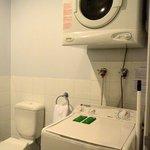 washing machine and dryer in bathroom